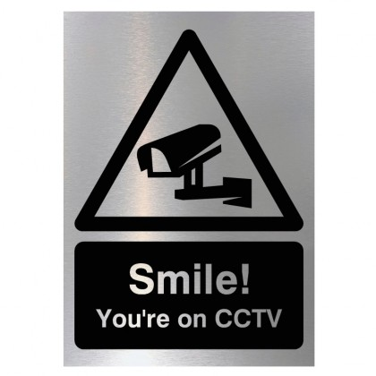 Smile You're On CCTV Sign in Brushed Silver